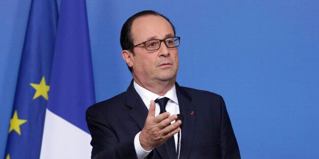 French President Francois Hollande addresses the media at the end of an EU summit at the European Council...