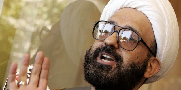 Man Monis, also known as Sheik Haron speaks to the media as he leaves Downing Centre Local Court in Sydney...