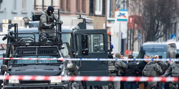 A member of the special forces police installs equipment on a van, in Ghent, western Belgium, Monday,...