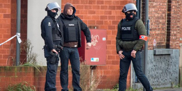 Special forces police guard a street in Ghent, western Belgium, Monday, Dec. 15, 2014. Four armed men...