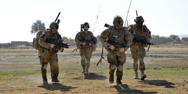 Soldiers cross open ground with Taliban bullets zipping over their headsThe patrol comes under fire from...