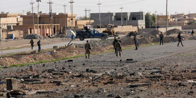 Iraqi security forces and Shiite fighters are deployed during a military operation to regain control...
