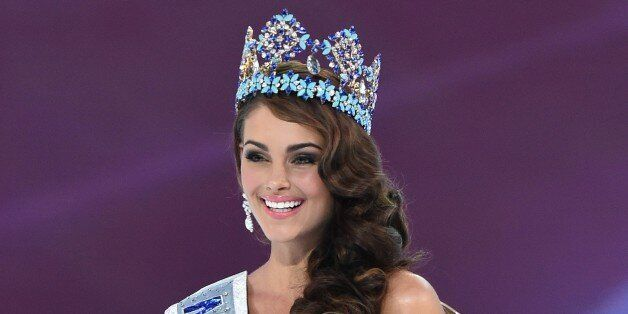 Miss South Africa and the 2014 Miss World, Rolene Strauss, poses in her seat after eing crowned during...