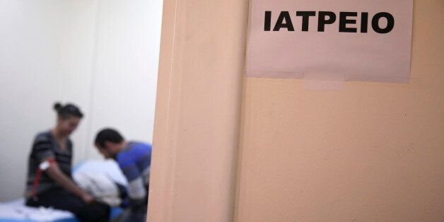 A drug user infected with the HIV virus, gives a blood sample at a public clinic in central Athens on...