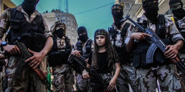 Children taking part in the military parade, which was organized by Al-Quds Brigades, the armed wing...