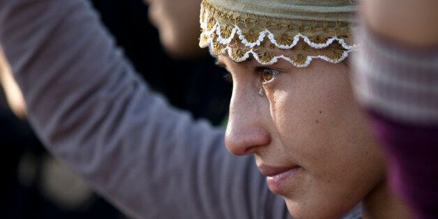 A girl cries during the funeral of 19 year-old Syrian Kurdish fighter girl Perwin Mustafa Dihap who died...