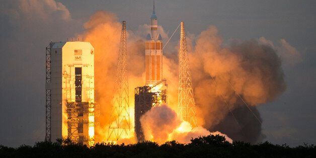 CAPE CANAVERAL , FL - December 5: The space craft Orion lifts off from the launch pad at Space Launch...