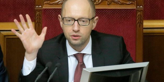 Ukrainian Prime Minister Arseniy Yatsenyuk speaks to lawmakers during the parliament session in Kiev,...