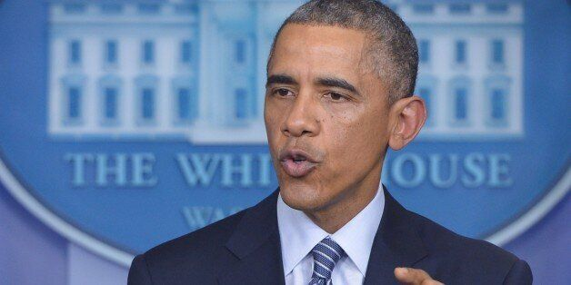 US President Barack Obama speaks following the announcement of the decision in the case of Ferguson police...