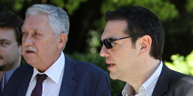 Leaders of the Radical Left party Alexis Tsipras, right, and the Democratic Left party Fotis Kouvelis...