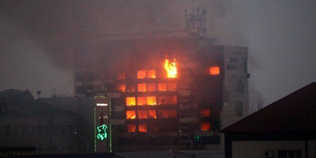 A publishing house building is seen in flames in the center of Grozny, Russia, early Thursday, Dec. 4,...