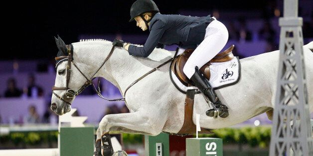 Athina Onassis de Miranda of Greece rides her horse Ad Crosshill rides her horse during the Gucci Paris...