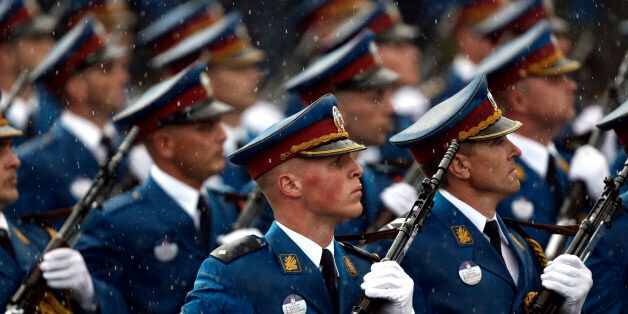 Serbian army Honor Guard members march during a military parade in Belgrade, Serbia, Thursday, Oct. 16,...