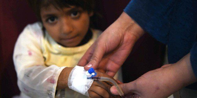 A Pakistani Thalassaemia patient receives blood at a treatment center in Peshawar on December 4, 2014....