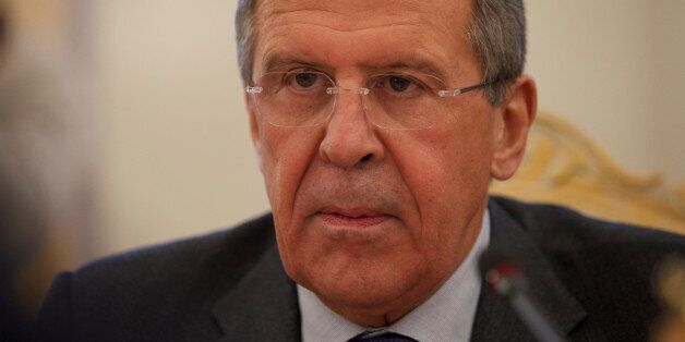Russian Foreign Miniser Sergey Lavrov listens to Thorbjorn Jagland, Secretary General of the Council...