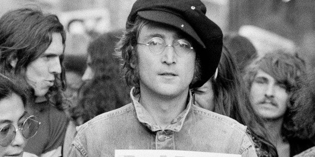 Portrait of British musician John Lennon (1940 - 1980) (center) and his wife, artist and musician Yoko...