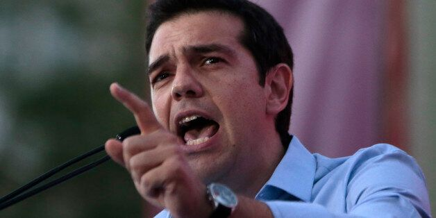 Greece's Left-wing opposition leader Alexis Tsipras addresses his party's supporters during a rally outside...