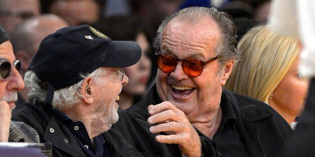 Actors Bruce Dern, left, and Jack Nicholson watch the Los Angeles Lakers play the Indiana Pacers during...