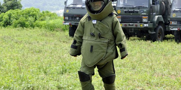 JAMMU, INDIA - AUGUST 14: An Indian army personnel of bomb disposal squad walks towards disposing a unexploded...