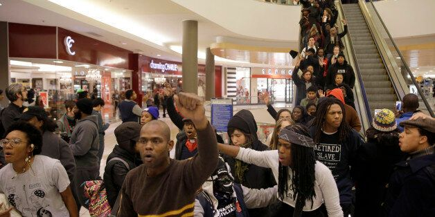 Protesters march inside Chesterfield Mall Friday, Nov. 28, 2014, in Chesterfield, Mo. The crowd disrupted...