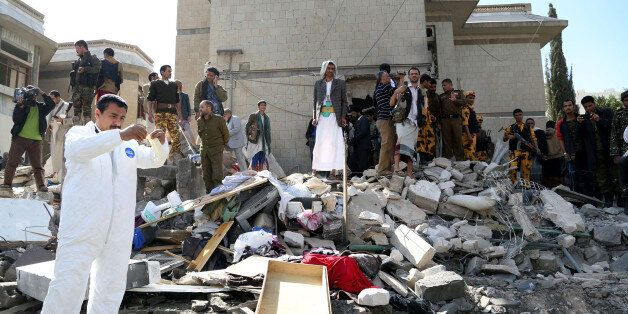 SANAA, YEMEN - DECEMBER 3: Yemeni security forces inspect the bombing area around the residence of the...