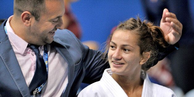 RIO DE JANEIRO, BRAZIL - AUGUST 27: Majlinda Kelmendi of Kosovo is congratulated by her coach, Dritton...