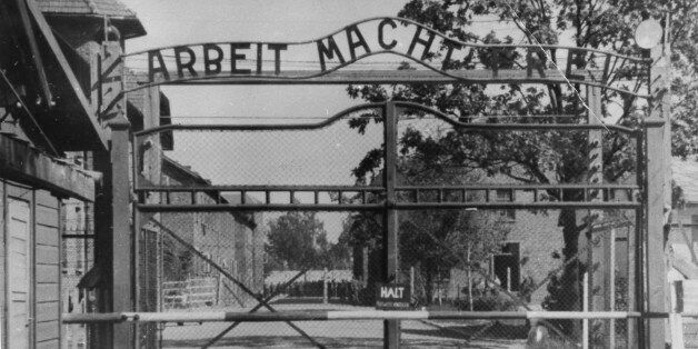 FILE - This undated file image shows the main gate of the Nazi concentration camp Auschwitz I, near Oswiecim...