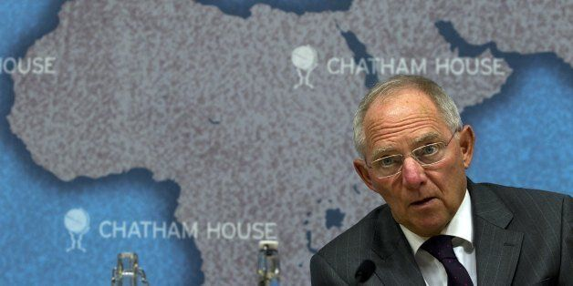 Dr Wolfgang Schäuble, Germany's Federal Minister of Finance, looks up while making a speech entitled...