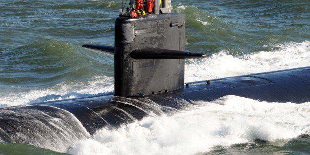 ATLANTIC OCEAN (Jan. 13, 2011) Sailors aboard the Los Angeles-class attack submarine USS Newport News...