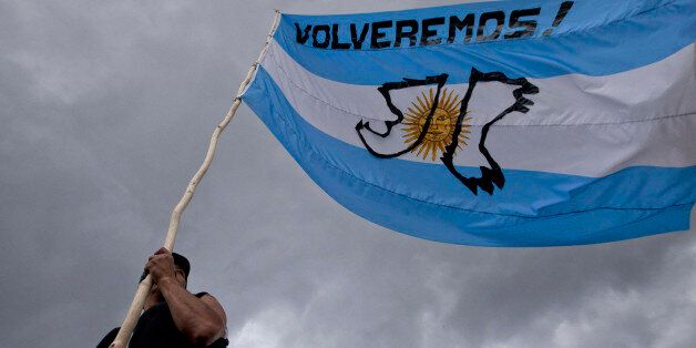 A man holds Argentina's national with a message that reads in