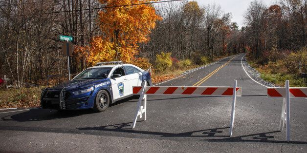 CRESCO, PA - OCTOBER 31: A Pocono Police car sits on the route to the hangar where Eric Matthew was captured...