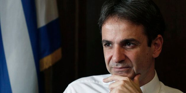 Greek Administrative Reform Minister Kyriakos Mitsotakis listens during an interview with the Associated...