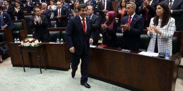 Turkey's Prime Minister Ahmet Davutoglu arrives to address members of the parliament of his ruling AK...