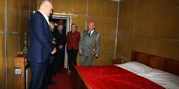 Albanian Prime Minister Edi Rama, left, looks at the bedroom of late communist dictator Enver Hoxha at...