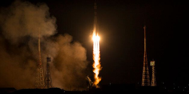 The Soyuz-FG rocket booster with Soyuz TMA-15M space ship carrying a new crew to the International Space...