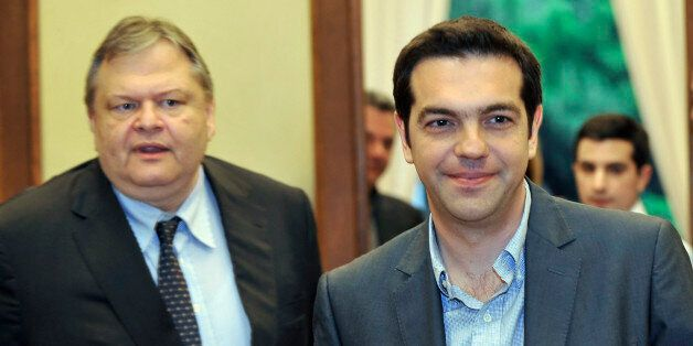 Greece's radical leftist party Syriza chief Alexis Tsipras (R) leaves the office of Socialists leader...