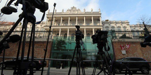 Cameras stand in front of Palais Coburg where closed-door nuclear talks of six world powers with Iran...