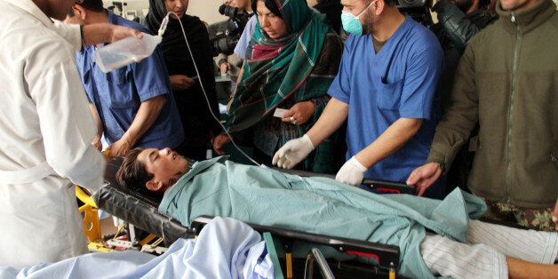 KABUL, AFGHANISTAN - NOVEMBER 24: An Afghan child who were injured in a suicide bomb attack targeted...