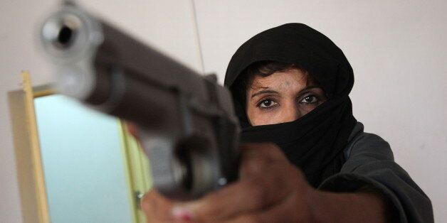 TO GO WITH Afghanistan-unrest-police-women, FOCUS by Daphne Benoit In this picture taken on June 7, 2010,...