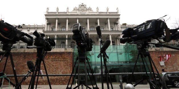 Cameras stand in front of Palais Coburg where closed-door nuclear talks with Iran take place in Vienna,...