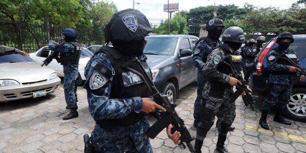 Police commandos custody the car where travels Honduran Juving Alexander Peralta, in Tegucigalpa on September...