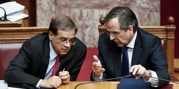 Greek Prime minister Antonis Samaras, right, chats with Greece's Finance Minister Gikas Hardouvelis during...