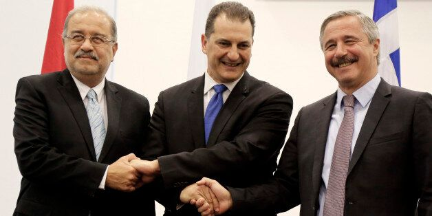 Cypriot Energy Minister Giorgos Lakkotrypis, center, shakes hands with his counterparts of Egypt Sherif...