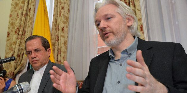 Ecuador's Foreign Minister Ricardo Patino, left, and WikiLeaks founder Julian Assange speak during a...