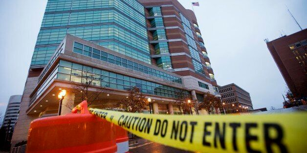 Barricades line the exterior of the Buzz Westfall Justice Center where a grand jury is expected to convene...