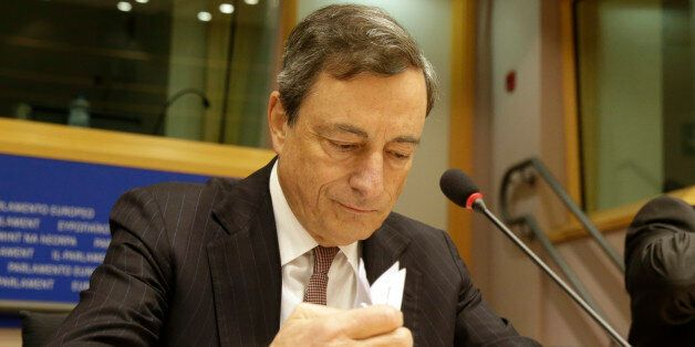 President of the European Central Bank Mario Draghi checks his papers prior to address the Committee...