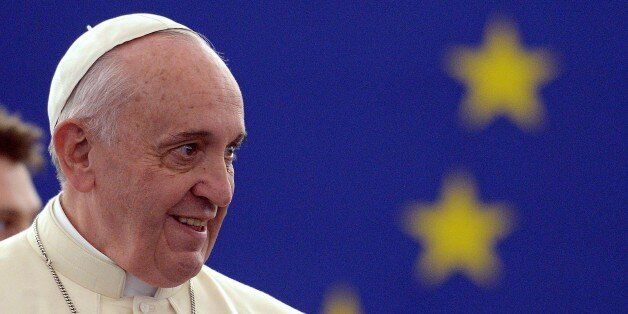 Pope Francis arrives to deliver a speech at the European Parliament, on November 25, 2014, during a short...