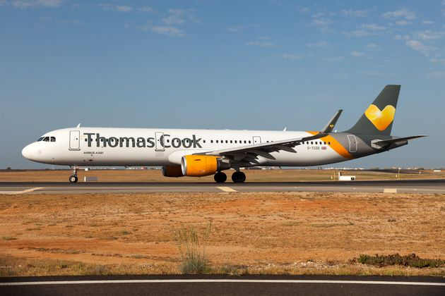 A Thomas Cook Airlines Airbus 321 prepares for takeoff at the Faro airport in southern Portugal on Aug....
