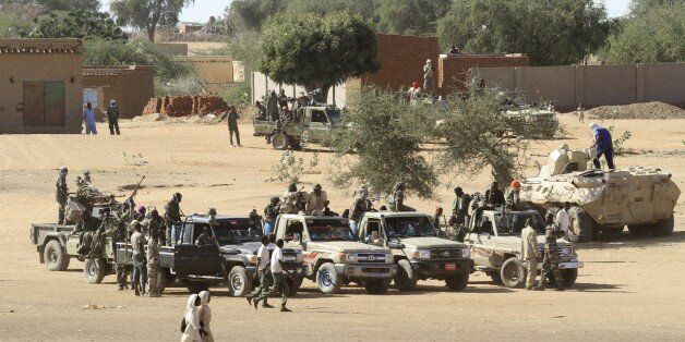 A picture taken during a government organised tour shows Sudanese troops standing guard in the village...
