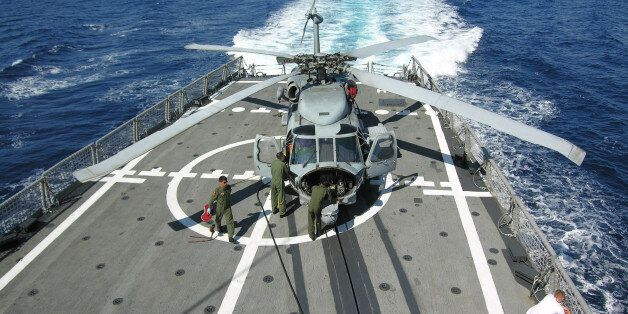 Navy technicians of the Turkish frigate, TCG Gemlik, prepare a Sikorsky SH70-B Seahawk helicopter for...
